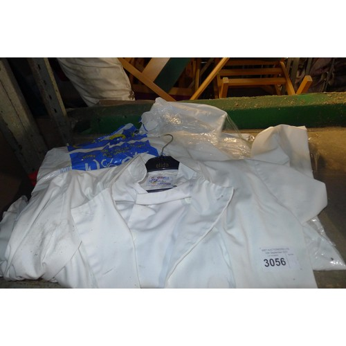 3056 - A quantity of various catering related items including tea towels, cloths, chef ware, contents of 1 ...