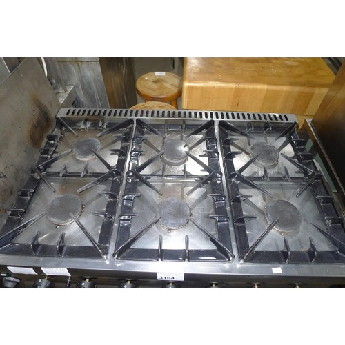 3164 - A gas fired 6 burner range with 2 door oven beneath by Lincat - trade