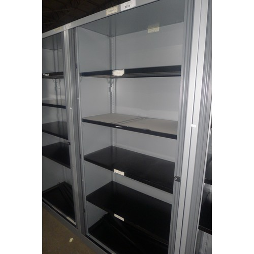 3310 - A tall metal office cabinet with 2 tambour doors and 4 adjustable shelves approx 100x47x197cm