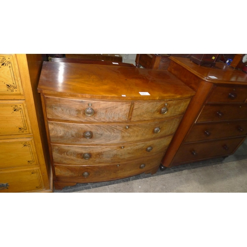 2465 - A 19th Century mahogany bow front chest of 2 short and 3 long graduated drawers with brass drop ring...