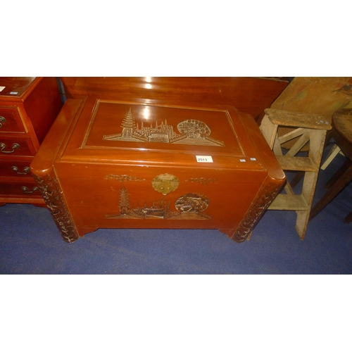 2513 - A vintage carved camphor wood chest with lift lid enclosing sliding tray