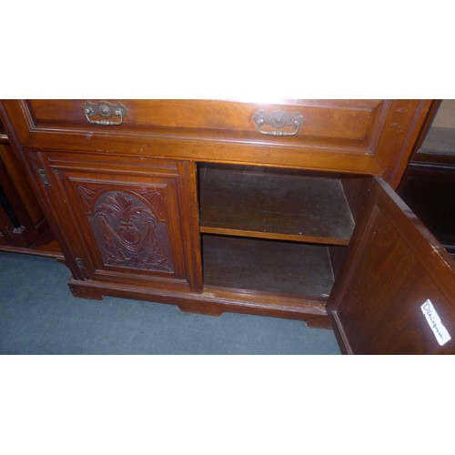 2326 - An Edwardian mahogany secretaire bookcase with two glazed doors above enclosing shelves, fitted fall...