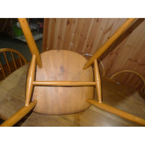 1237 - An Ercol style dining table approx 152 x 77cm (possibly by Ercol but no make / labels are visible) a...