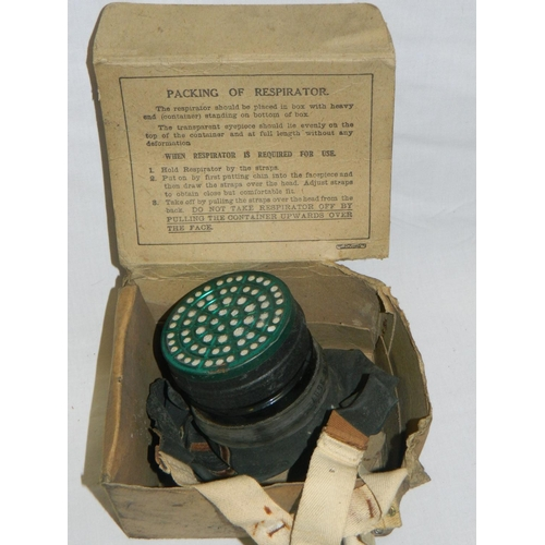 105 - Vintage gas mask with its original box...