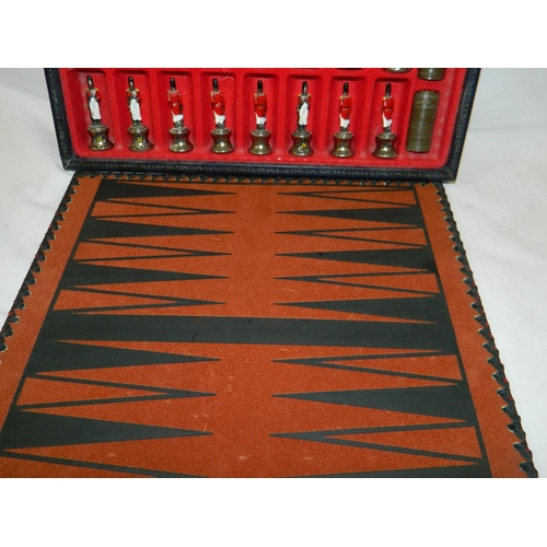 11 - White & Yellow metal effect hand-painted Napoleon chess set & backgammon in a suede leather box...