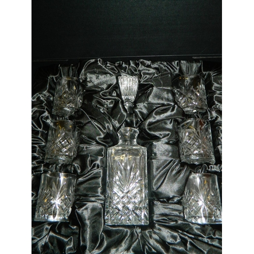 110 - New quality crystal decanter and glasses set in display case...
