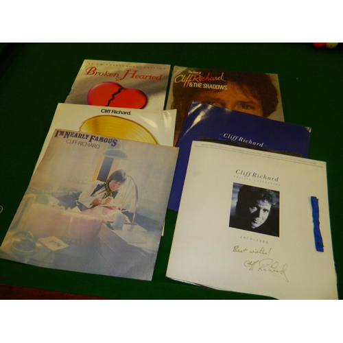 116 - Cliff Richards memorabilia, 12 Cliff Richards vinyl LPs[ including 1 signed by Cliff , very rare,] a...