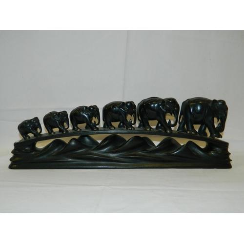 173 - Ebonised carved elephant bridge...