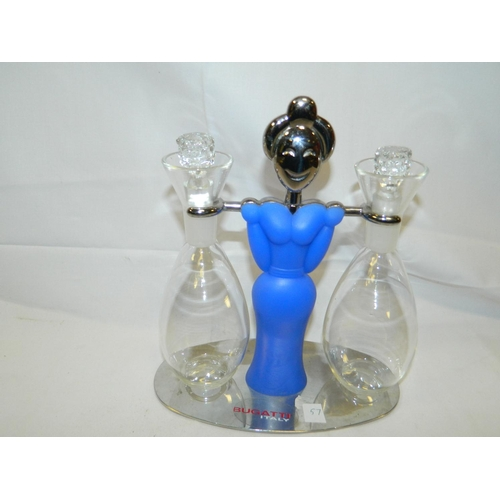 19 - Bugatti oil and vinegar set on stand in shape of lady in blue...
