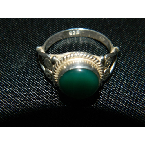 191 - Silver ring set with a green stone [size L]...