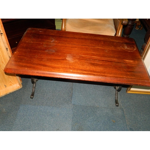 212 - Coffee table with wrought iron base [ possibly from a sewing machine]...