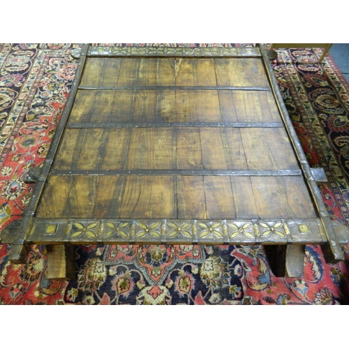217 - Rajistan converted oxcart solid teak table with metal trim...