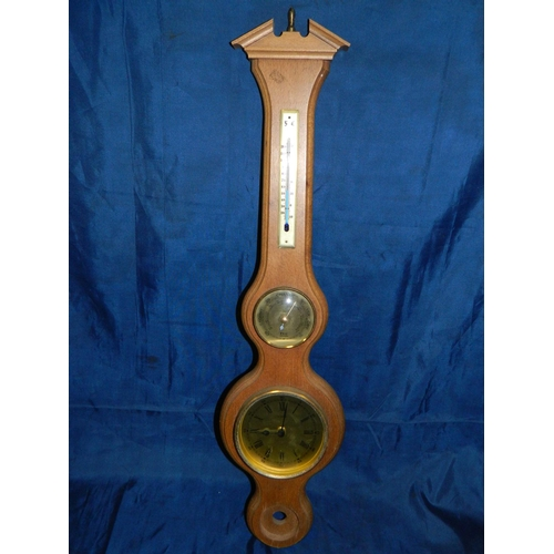 237 - Combination barometer, clock and thermometer in wooden case...