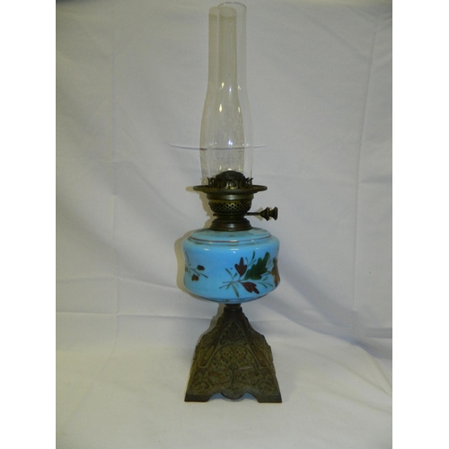 239 - Victorian oil lamp with wrought iron base and blue floral oil reservoir...