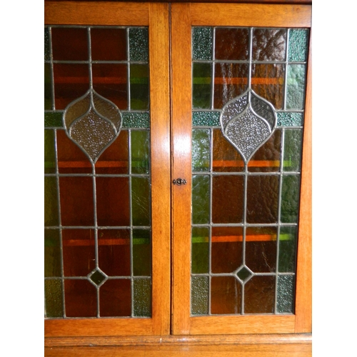 242 - Edwardian lead glazed 2 door book cabinet with cupboard...