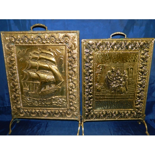 255 - 2 Vintage brass fire screens...