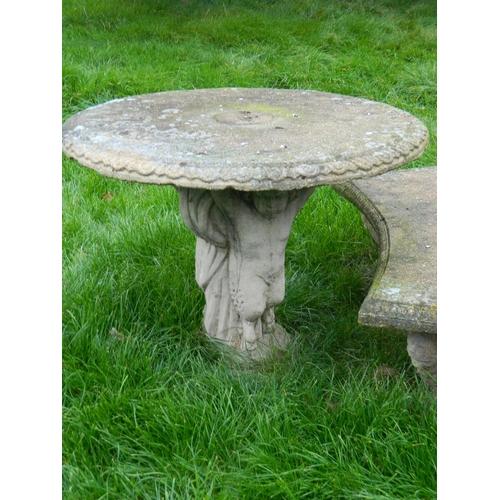 266 - Garden stone style cherub design table (matching lot 267)...