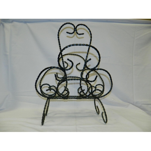 301 - Wrought iron magazine rack...