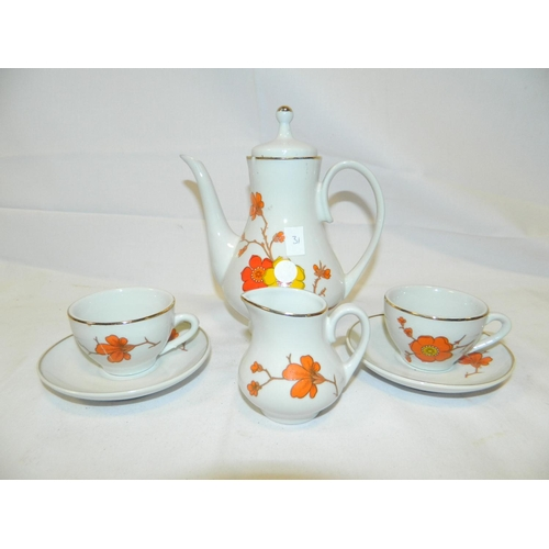 318 - Small coffee pot, 2 cups and milk jug with floral design...