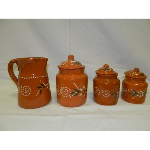 331 - Matching jug and canister set terracotta colour with spiral designs 4 pieces...