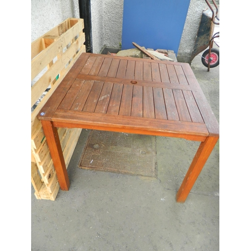 343 - 1m square teak table with parasol holder...