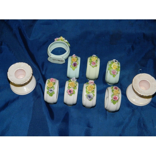 357 - 8 Porcelain napkin rings and 2 porcelain candle holders...