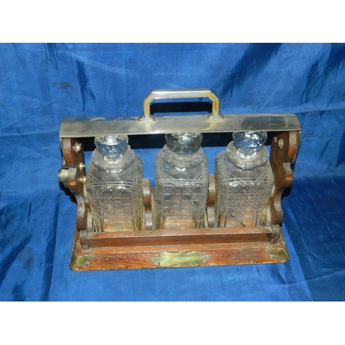 37 - Late Victorian 3 decanter tantalus with key...
