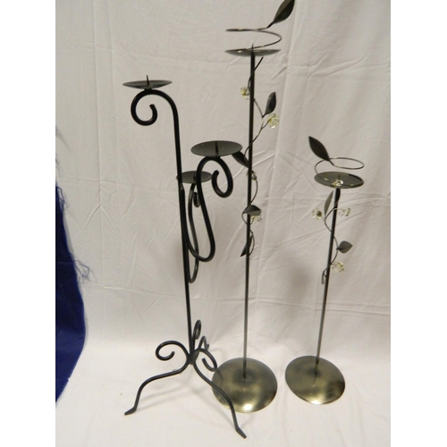 407 - Matching pair floor candle holders and a wrought iron candle holder...