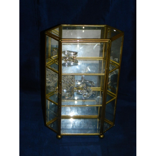 428 - Small brass and glass display case with swarovski miniature items within...