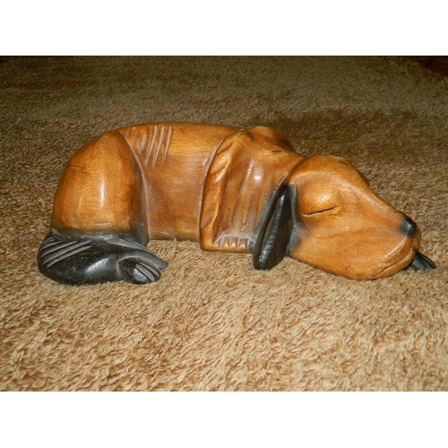 43 - Solid beech carved sleeping beagle...