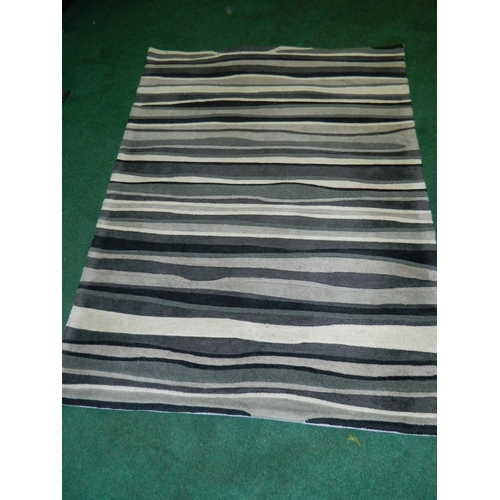 464 - Black/ Grey striped rug [120x70cm]...