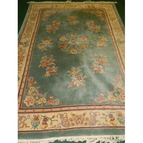 489 - Green based Chinese rug [280x180cm]...