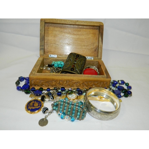 511 - Wooden box containing costume jewelery...