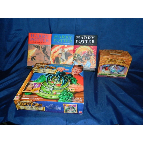 544 - Collection of Harry Potter Collectables. 3 First Edition Books, a mug and saucer and collectable mat...