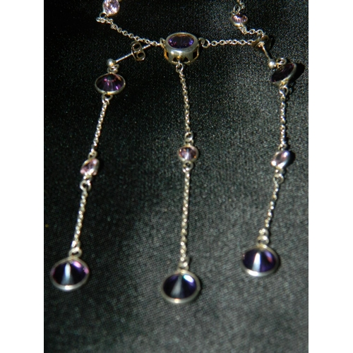 558 - 925 Silver necklace and earings set with amethysts...
