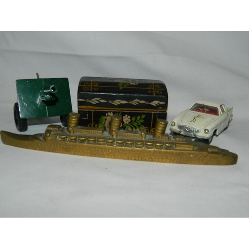 568 - 2 Toys [model of Saint car and a gun carriage] and a paperweight in the form of a brass ship...
