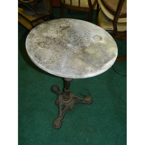 590 - Wrought iron garden table with marble top...
