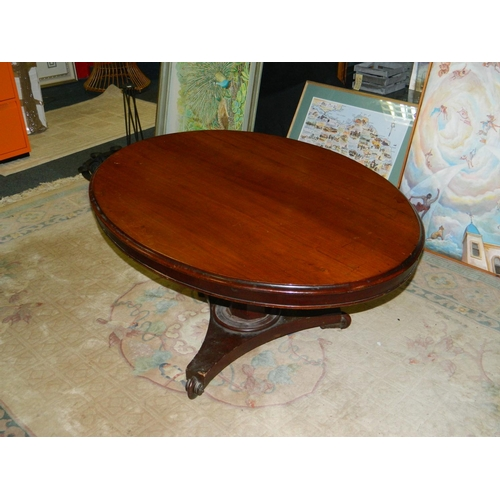 600 - Low Victorian oval occasional table on tripod legs...