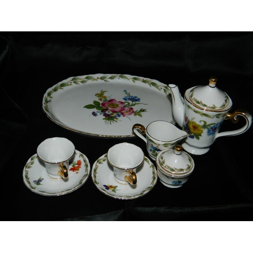 68 - Minature 'Regal' 2 piece tea set on tray...