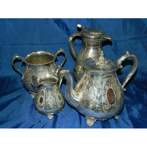 73 - 4 Pieces engraved silver plate [teapot, water jug and milk and sugar]...