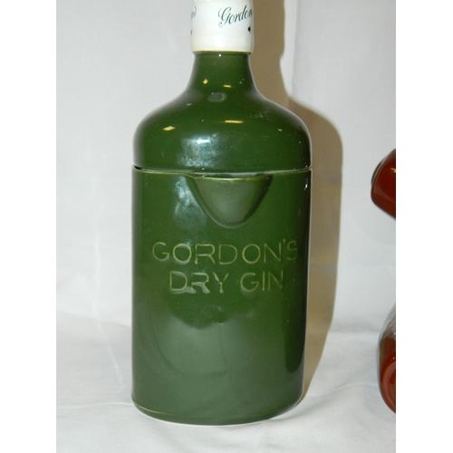 81 - Stoneware teddy bear cookie jar and porcelain water jug shaped as Gordons gin bottle...