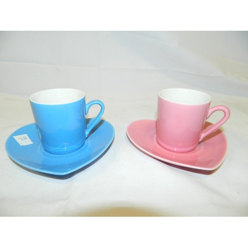 9 - 2 heart shaped bone china saucers and coffee cups...