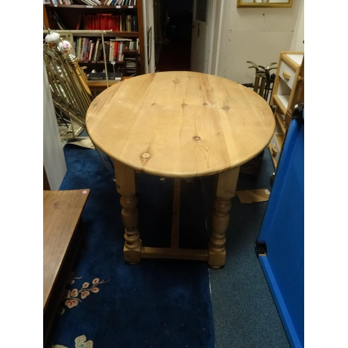 688 - Modern solid oval pine table...
