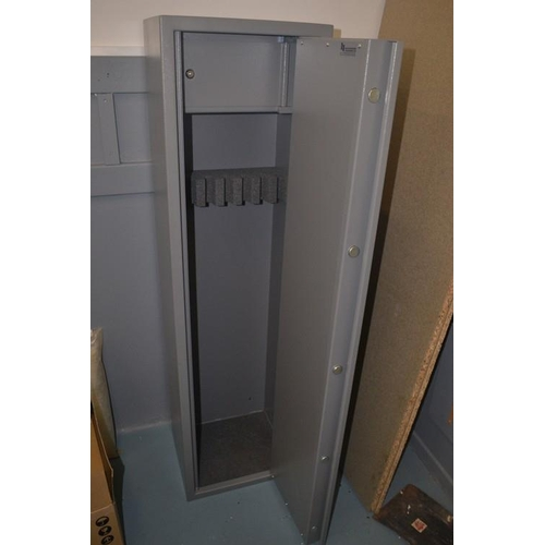 6 - Solid almost new gun cabinet approx 152cm tall, 40 by 34cm. Holds upto 7 guns with and ammo safe and...