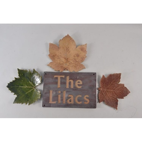 44 - Stoneware 'The Lilacs' House Sign' and 3 pottery maple leaves...