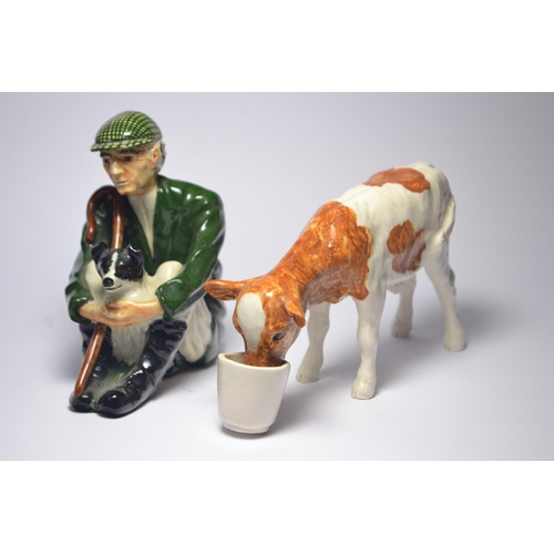 37 - SHEBEG pottery model of a farmer and his dog, together with a model of a Ayrshire calf.[2] {H: 11and...
