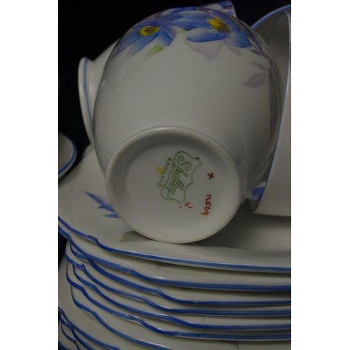 14 - Shelley china tea set, decorated with blue flower design. 12 place setting with sugar and cream and ...