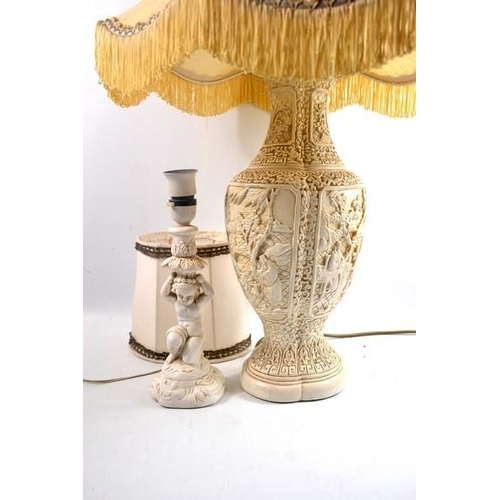 34 - Pair of lamps - one oriental good quality base, one cherub style - 42cm H and 21cm H respectively...