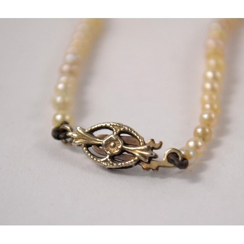 15 - White gold clasped string of pearl necklace...