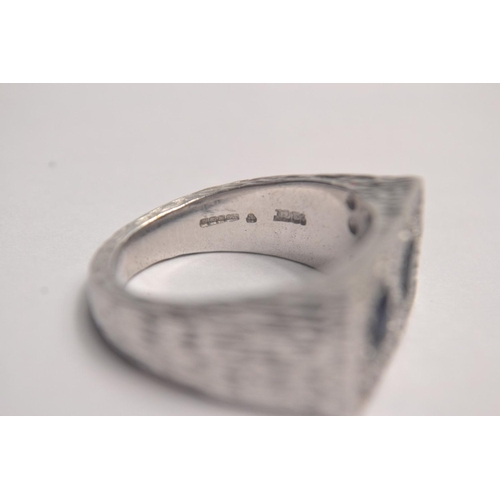 26 - Fabulous Modern 18ct white gold textured shank sapphire and diamond dress ring, set with 2 oval cut ...